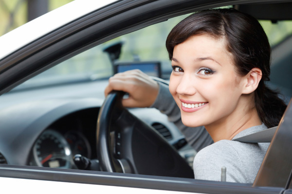 happy-young-girl-in-car_mam3k8